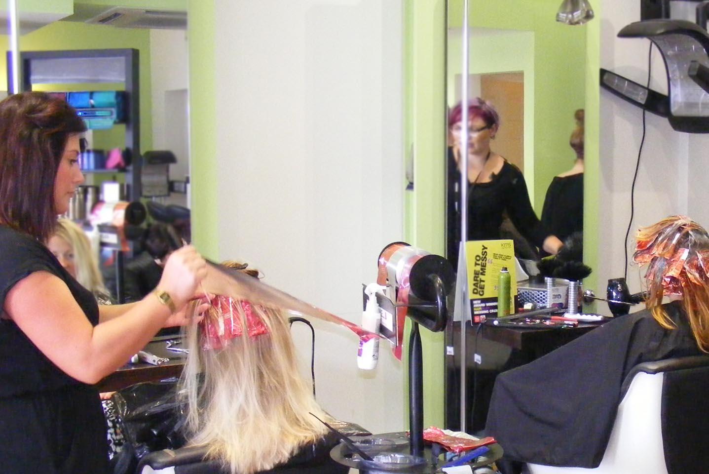 Hair Stylist styles clients hair in busy Hair Salon - Nuneaton Hair Salon - Hair Cutts